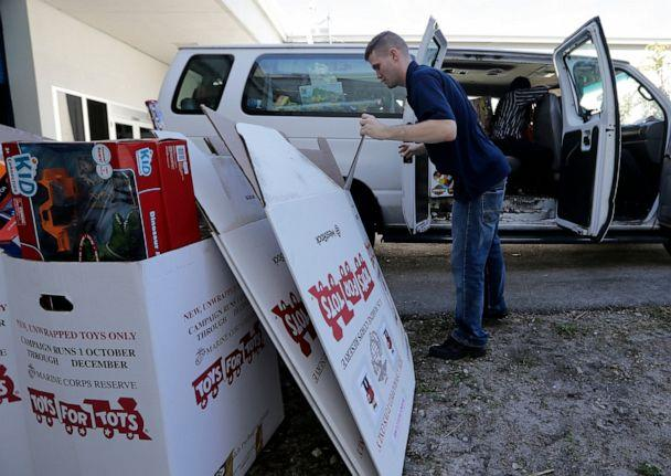 PHOTO: Staff Sgt. Brian Spittler loads a vehicle with toy donations at the Marine Corps Toys for Tots depot, Wednesday, Dec. 19, 2018, in Hialeah, Fla. (Lynne Sladky/AP, File)