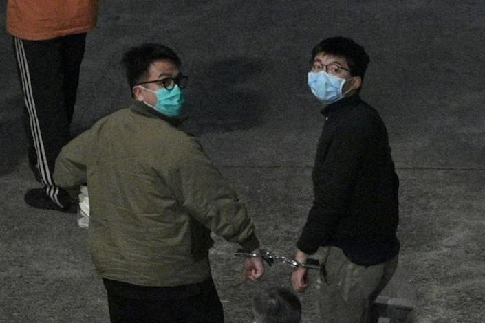 Fellow youth activists Joshua Wong (R) and Ivan Lam (L) were sentenced in the same case Agnes Chow