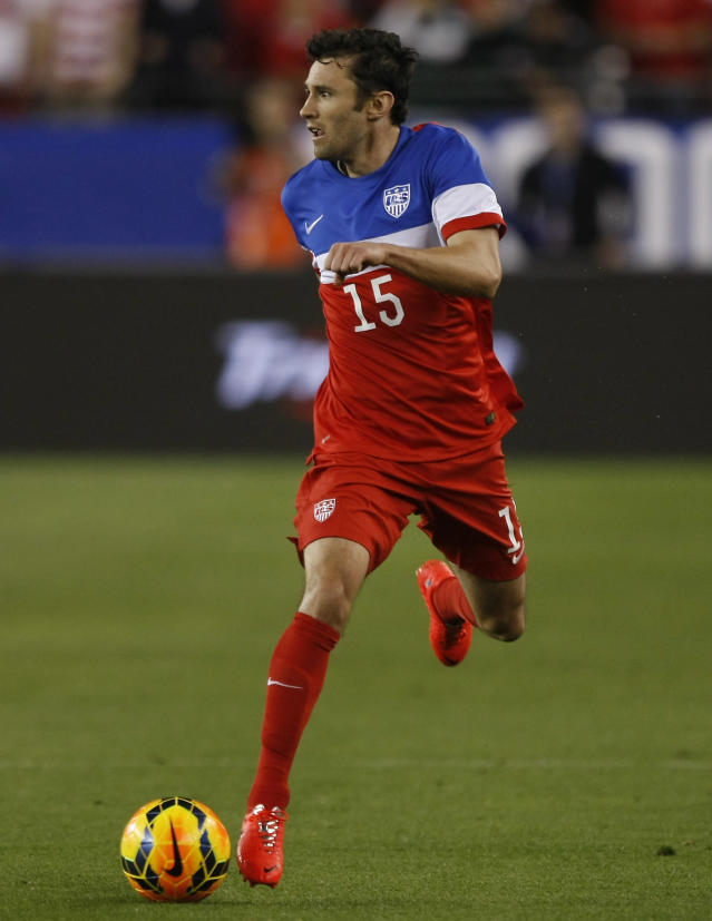 U.S. defenseman Michael Parkhurst (15) carries the ball against Mexico during the second half of an international friendly soccer match Wednesday, April 2, 2014, in Glendale, Ariz. The game ended in a 2-2 draw. (AP Photo/Rock Scuteri)