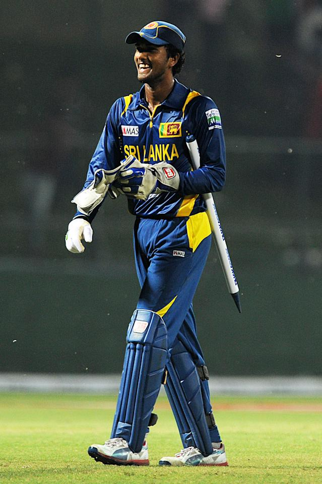 Sri Lanka's Twenty20 cricket captain Dinesh Chandimal walks back to the pavilion after their victory during the Twenty20 International match between Sri Lanka and Bangladesh at The Pallekele International Cricket Stadium in Pallekele on March 31, 2013. AFP PHOTO/ Ishara S. KODIKARA