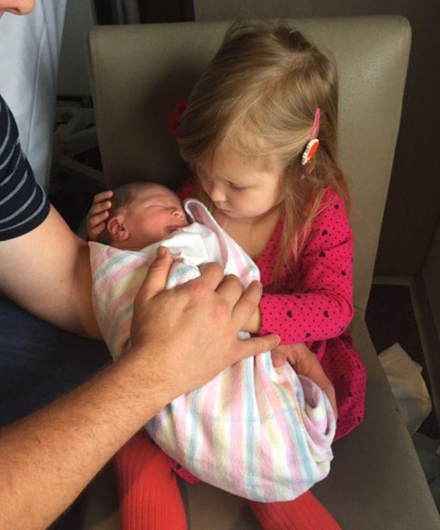 Young Frankie holds her new baby brother. Image: Supplied