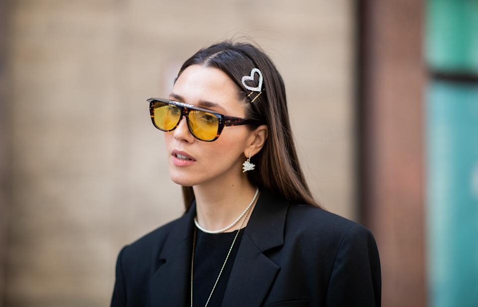 Not only do novelty-shaped clips add visual interest, but they're also great for keeping shorter layers out of your face in the heat. Add a pair over colorful sunnies and you're good to go.