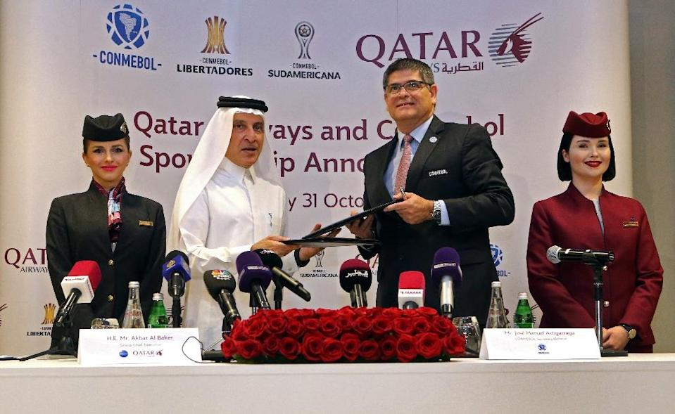 Chief Excecutive Officer (CEO) of Qatar Airways Akbar al-Baker (2nd L) and Jose Manuel Astigarraga, the secretary general of the South American football federation CONMEBOL, sign a sponsorship agreement in Doha on October 31, 2018 (AFP Photo/STRINGER)
