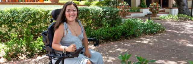Sylvia Colt-Lacayo has a neuromuscular disease and needs help from a caregiver to perform certain daily functions. (Heidi de Marco/KHN)