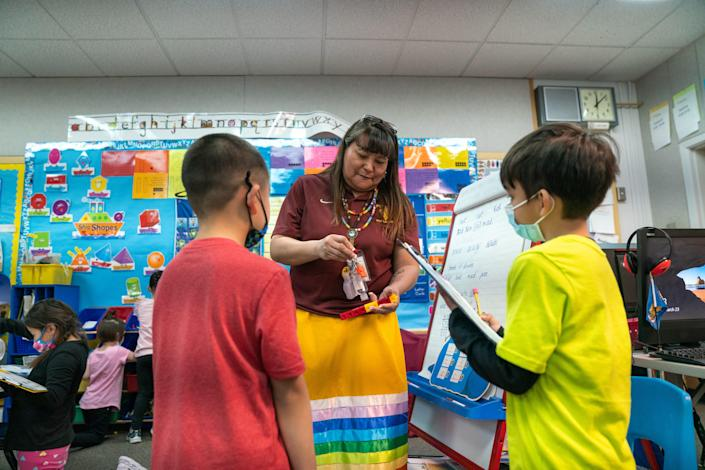 Teacher Shari Daniels helps her kindergarten students identify shapes in her classroom. Daniels, 48, never considered teaching as a career when she attended Poplar schools as a kid growing up on the Fort Peck Reservation.