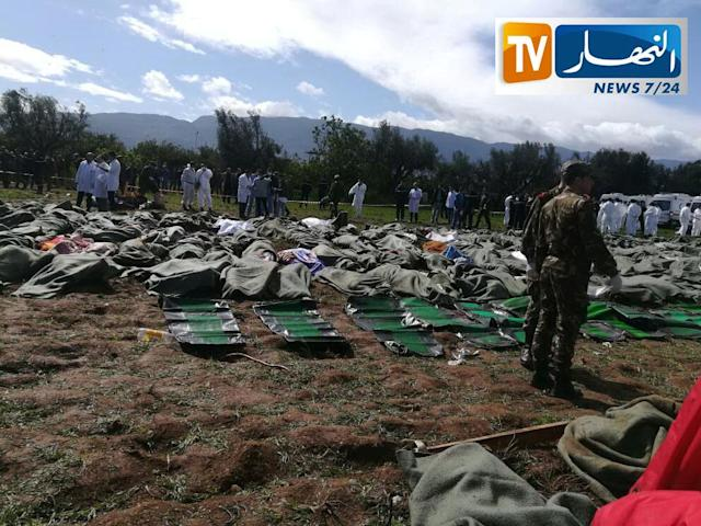 <p>Bodies of victims are covered with blankets after Algerian military plane crashed near an airport outside the capital Algiers, Algeria April 11, 2018 in this still image taken from a video. (Photo: ENNAHAR TV/Handout/ via Reuters) </p>