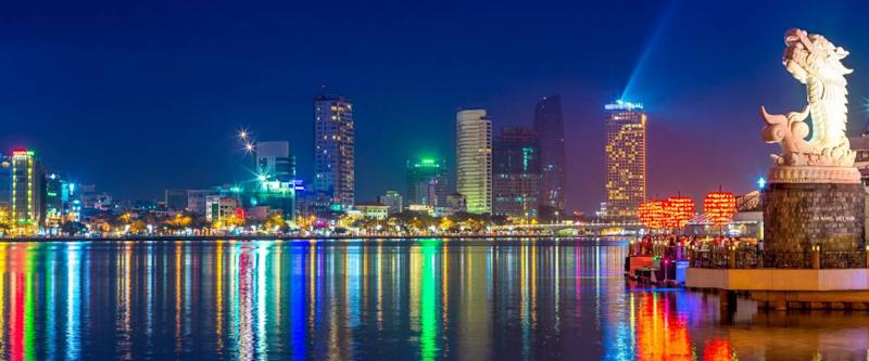 skyline of da nang by han river with carp dragon
