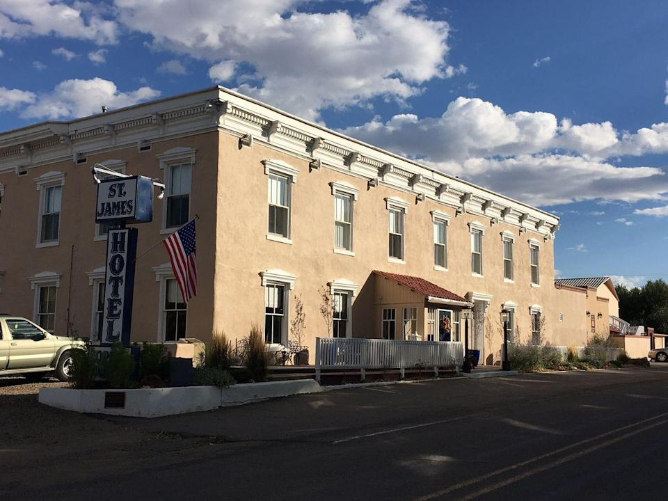 """<p>If you're looking for A-List ghosts, pack your bags and head to the St. James Hotel, which purports to have the spirits of such Wild West notables as Wyatt Earp, Jesse James, Clay Allison, Black Jack Ketchum, Billy the Kid, and Thomas James Wright roaming its halls.<br></p><p> <a class=""""link rapid-noclick-resp"""" href=""""https://go.redirectingat.com?id=74968X1596630&url=https%3A%2F%2Fwww.tripadvisor.com%2FHotel_Review-g46983-d115795-Reviews-Express_St_James_Hotel-Cimarron_New_Mexico.html&sref=https%3A%2F%2Fwww.countryliving.com%2Flife%2Ftravel%2Fg2689%2Fmost-haunted-hotels-in-america%2F"""" rel=""""nofollow noopener"""" target=""""_blank"""" data-ylk=""""slk:PLAN YOUR TRIP"""">PLAN YOUR TRIP</a></p>"""