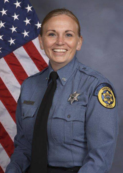 This undated photo provided by Kansas City, Kansas police department shows Deputy Theresa King. Kansas City police confirmed that King, 44, died just after midnight following a shooting on Friday, June 15, 2018. Officer Patrick Rohrer, 35, died earlier. An inmate who was being transported in Kansas City overpowered two officers and shot them. The inmate was also shot during the confrontation, his condition was not known. Investigators said the inmate may have grabbed a weapon from one of the deputies during a struggle after he got out of a van late Friday morning. (Kansas City Kansas police department via AP)