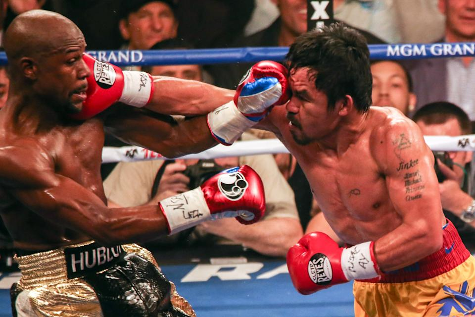 LAS VEGAS, NEVADA - MAY 2: World welterweight championship bout between Floyd Mayweather Jr. and Manny Pacquiao at MGM Grand Garden Arena on May 2, 2015, in Las Vegas, Nevada. (Photo by Benjamin Lowy/Getty Images)