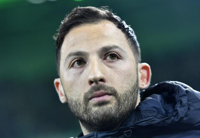 FILE - In this Dec. 9, 2017 file photo Schalke's head coach Domenico Tedesco watches during the German Bundesliga soccer match between Borussia Moenchengladbach and FC Schalke 04 in Moenchengladbach, Germany. With eight games of the season remaining, Tedescos side is best-placed for a return to the Champions League along with soon-to-be-crowned champion Bayern Munich. (AP Photo/Martin Meissner, file)