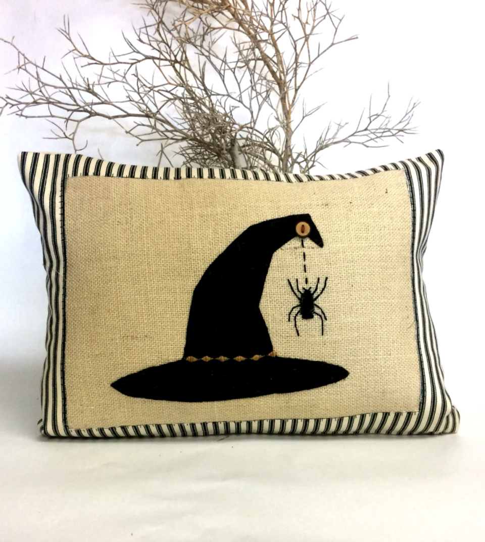 Witches Hat Halloween Pillow on tweed background and black and white stripes