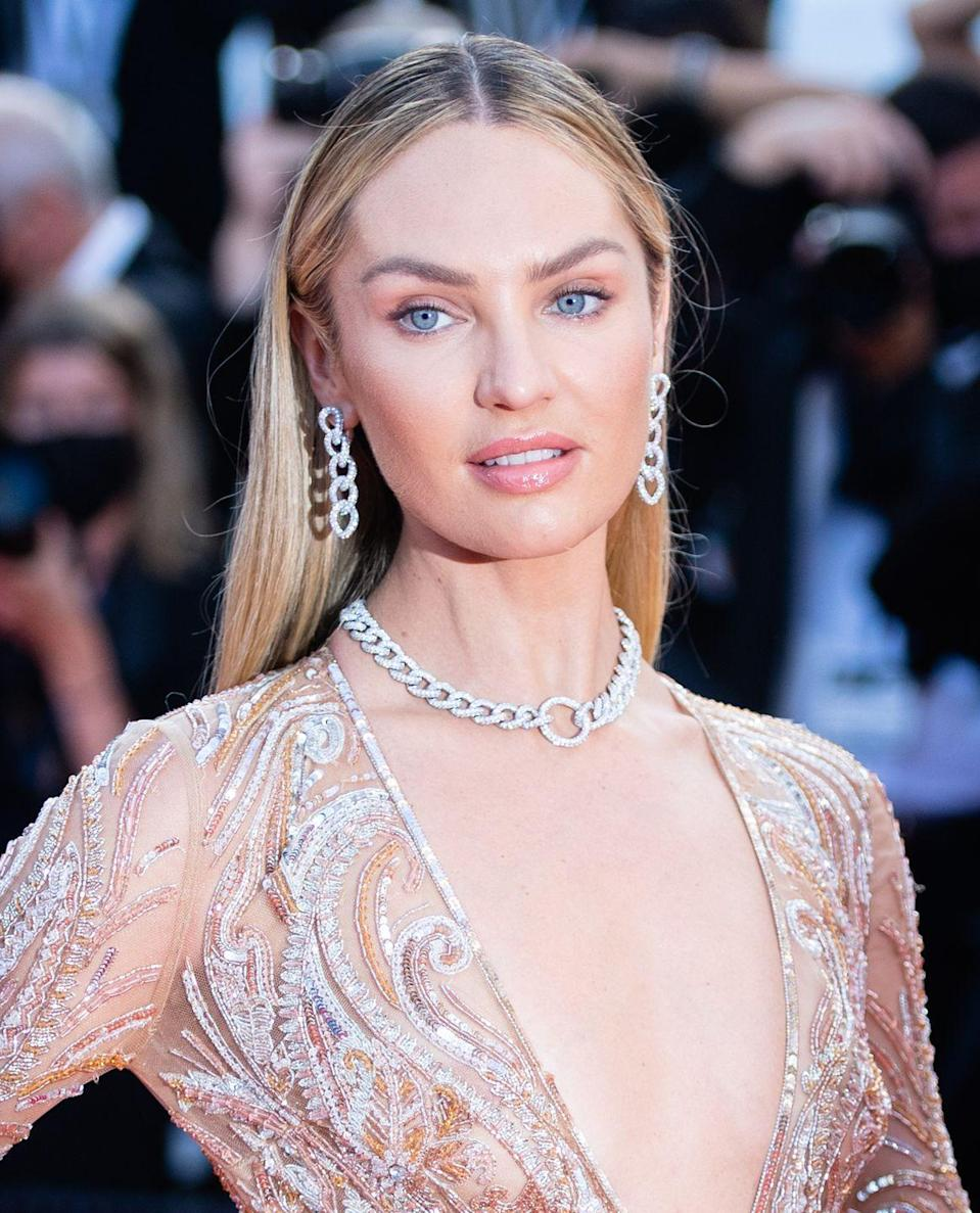 <p>The South African supermodel opted to wear Pomellato's 'Catene' necklace and matching earrings. Named after the Italian word for 'chain', the pieces play on the jeweller's signature motif with white gold links encrusted in twinkling white diamonds. </p>
