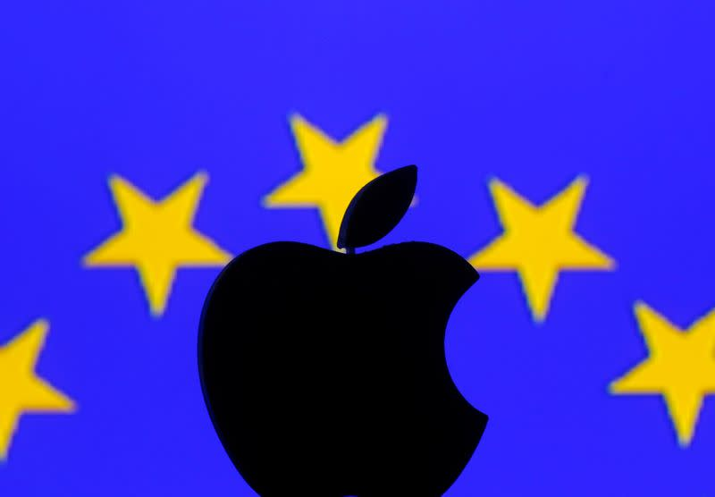 A 3D printed Apple logo is seen in front of a displayed European Union flag in this illustration