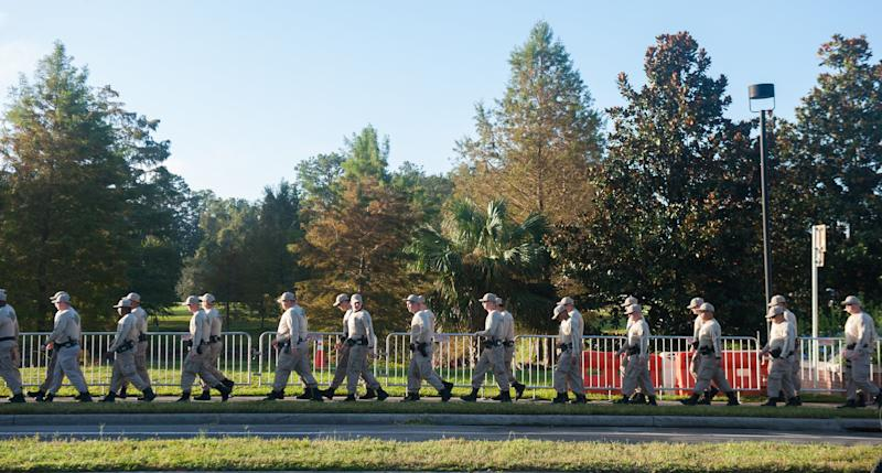 Florida State Troopers walk from their hotel to the University of Florida Campus before a speaking event by Richard Spencer on Thursday October 19 2017 in Gainesville
