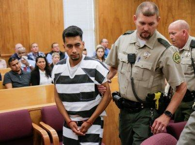 FILE PHOTO: Cristhian Rivera, 24, accused of killing University of Iowa student Mollie Tibbetts, is led from the courtroom after making his initial appearance on a charge of first-degree murder during at the Poweshiek County Courthouse in Montezuma, Iowa, U.S., August 22, 2018. Jim Slosiarek/The Gazette/Pool via REUTERS/File Photo