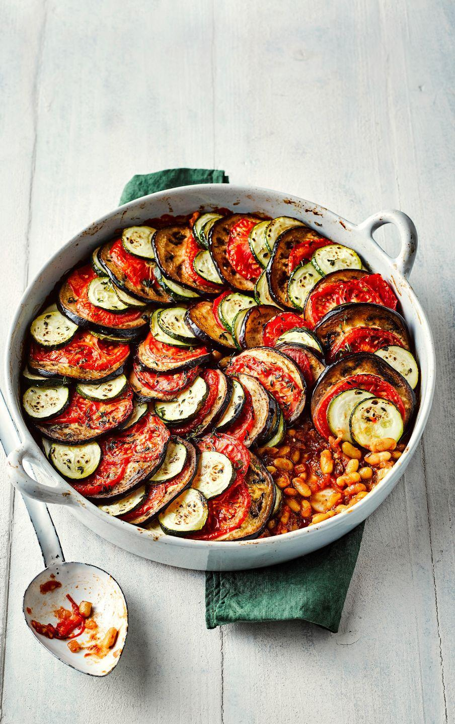 "<p>This vegan ratatouille recipe is a beautiful French dish, and the perfect midweek meal.</p><p><strong>Recipe: <a href=""https://www.goodhousekeeping.com/uk/food/recipes/a25935574/vegan-ratatouille/"" rel=""nofollow noopener"" target=""_blank"" data-ylk=""slk:Ratatouille"" class=""link rapid-noclick-resp"">Ratatouille </a></strong></p>"