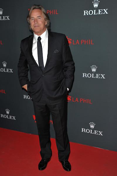"""FILE - In this Thurs., Sept. 27, 2012 file photo, Don Johnson arrives at the Los Angeles Philharmonic's 2012 Opening Night Gala, in Los Angeles. An appeals court on Monday Oct. 1, 2012 trimmed Johnson's $23.2 million verdict over """"Nash Bridges"""" profits down to $15 million plus interest after determining that jurors mistakenly awarded Johnson interest in their original verdict. (Photo by Richard Shotwell/Invision/AP, File)"""