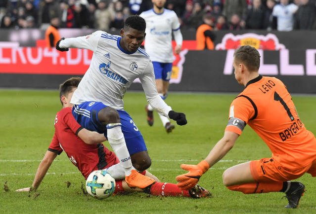 Leverkusen's Panagiotis Retsos fouls Schalke's Breel Emboli which leads to a penalty during the German Bundesliga soccer match between Bayer Leverkusen and FC Schalke 04 in Leverkusen, Germany, Sunday, Feb 25, 2018. (AP Photo/Martin Meissner)
