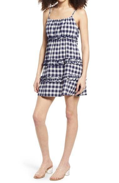 <p>If you simply can't wait until the weather is warm enough to wear this <span>Speechless Gingham Ruffle Tier Minidress</span> ($49), just slip it on with a denim jacket in the meantime. </p>