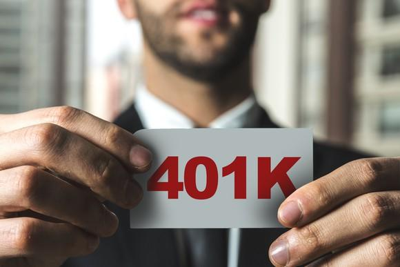Man holding piece of paper reading 401K