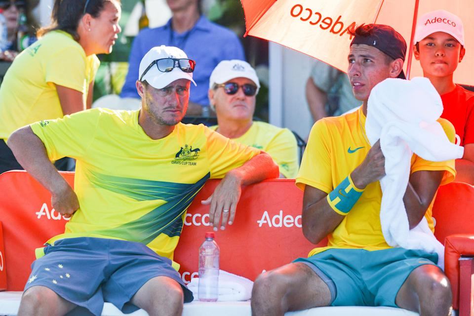 Alexei Popyrin (pictured right) sits with team captain Lleyton Hewitt (pictured left) as he plays against Bosnia and Herzegovina's Nerman Fatic in their Davis Cup.