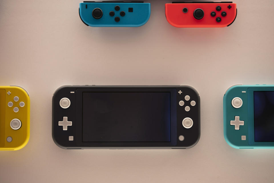 FILE - In this Thursday, Jan, 23, 2020 file photo, Nintendo Switch game consoles are on display at Nintendo's official store in the Shibuya district of Tokyo. Time spent playing video games can be good for mental health, according to a new study by researchers at Oxford University. The finding comes as video game sales this year have boomed as more people are stuck at home because of the pandemic and many countries have once again imposed limits on public life. The paper released Monday, NOv. 16, 2020 is based on survey responses from people who played two games, Plants vs Zombies: Battle for Neighborville and Animal Crossing: New Horizons. (AP Photo/Jae C. Hong, File)