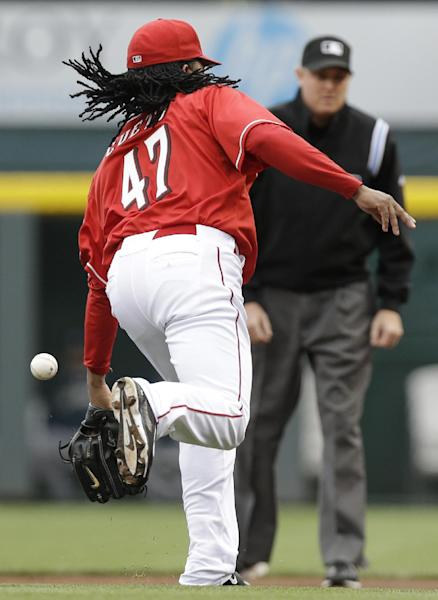 Cincinnati Reds starting pitcher Johnny Cueto bobbles a bunt single by San Diego Padres' Will Venable in the first inning of a baseball game, Thursday, May 15, 2014, in Cincinnati. (AP Photo/Al Behrman)