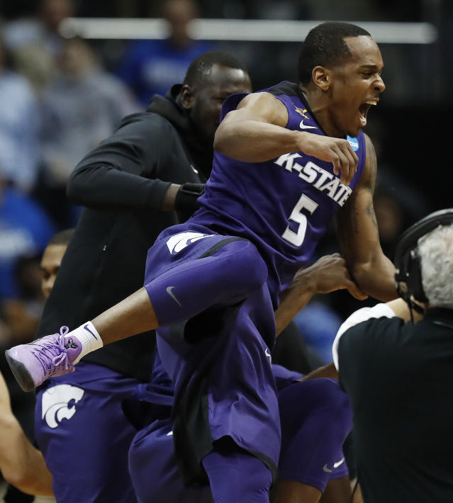 Kansas State guard Barry Brown (5) celebrates after a regional semifinal NCAA college basketball tournament game against Kentucky, Friday, March 23, 2018, in Atlanta. Kansas State won 61-58. (AP Photo/David Goldman)