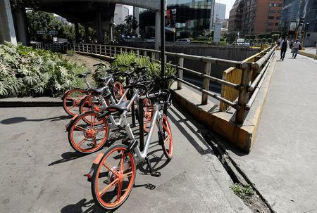 Mobikes are parked next to an avenue after Chinese bike sharing company MOBIKE launched its service in Mexico City, Mexico February 28, 2018. REUTERS/Henry Romero/Files