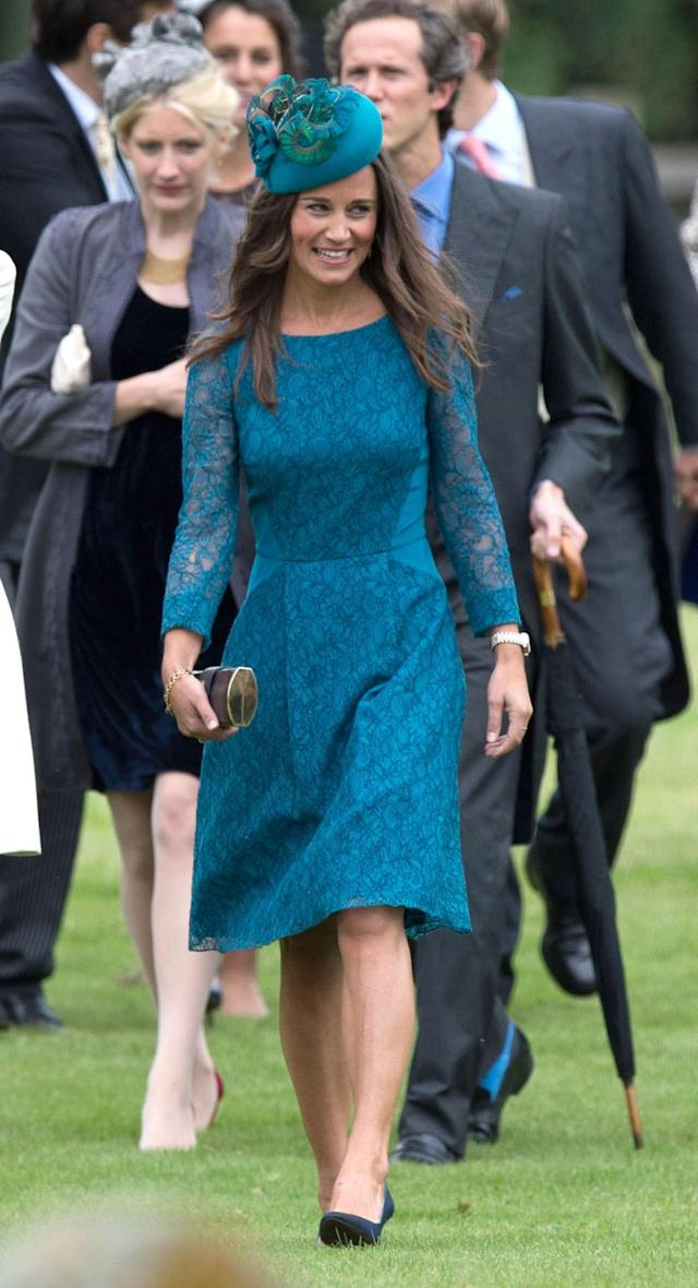 <p>For James Meade's wedding to Lady Laura Marsham at St. Nicholas Church in Gayton, Pippa wore a teal midi dress with a matching hat. <em>[Photo: PA]</em> </p>