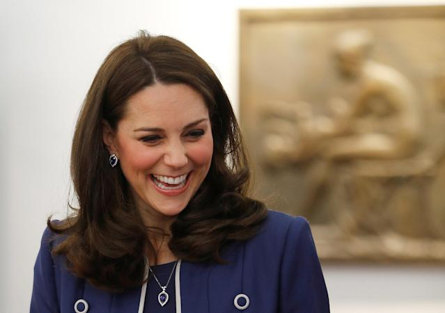 The Duchess of Cambridge showcased her growing bump on a visit to a gynecology center in London. (Photo: Getty)