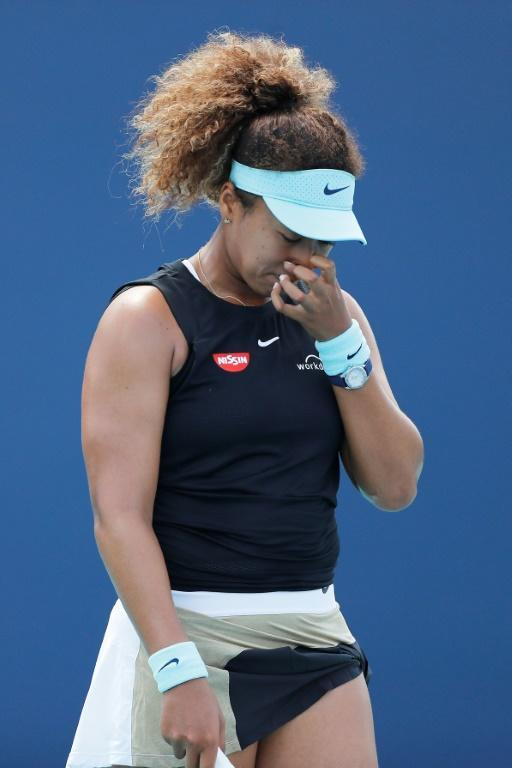 Naomi Osaka of Japan reacts during her quarter-final loss to Greece's Maria Sakkari in the ATP and WTA Miami Open