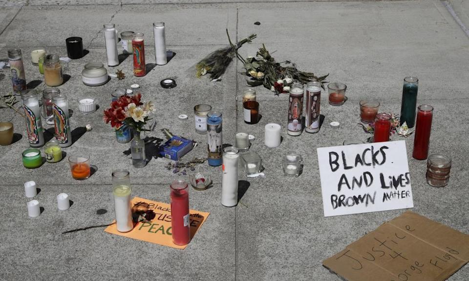 A memorial in front of Vallejo's city hall bears a sign reading 'Blacks and Brown lives matter'.