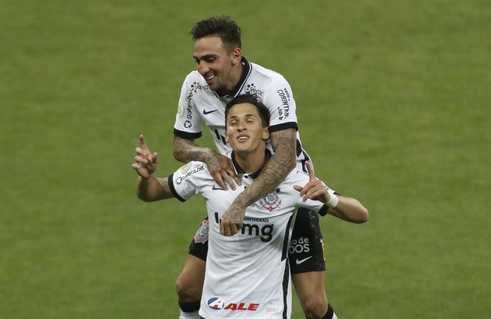 SAO PAULO, BRAZIL - JANUARY 21: Mateus Vital of Corinthians celebrates with teammate Gustavo Mosquito after scoring the second goal of his team during a match between Corinthians and Sport Recife as part of Brasileirao Series A 2020 at Neo Quimica Arena on January 21, 2021 in Sao Paulo, Brazil. (Photo by Miguel Schincariol/Getty Images)