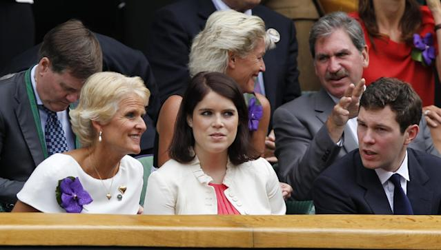Princess Eugenie, center, and Jack Brooksbank, right, sit in the Royal Box on centre court prior to the women's singles final between Eugenie Bouchard of Canada and Petra Kvitova of the Czech Republic at the All England Lawn Tennis Championships in Wimbledon, London, Saturday July 5, 2014. (AP Photo/Sang Tan)