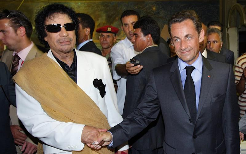 French president Nicolas Sarkozy shakes hands with Libyan leader Muammar Gaddafi(L) upon his arrival for an official visit to Tripoli in 2007.