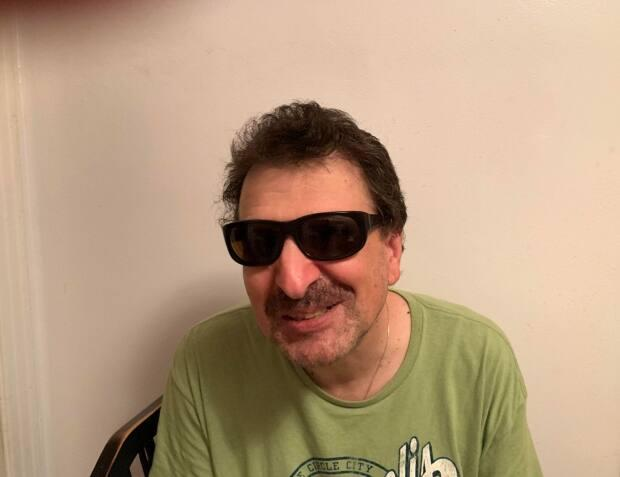 Peter Nikolantonakis advocates for Montrealers living with a visual impairment. (Submitted by Costa Nikols - image credit)
