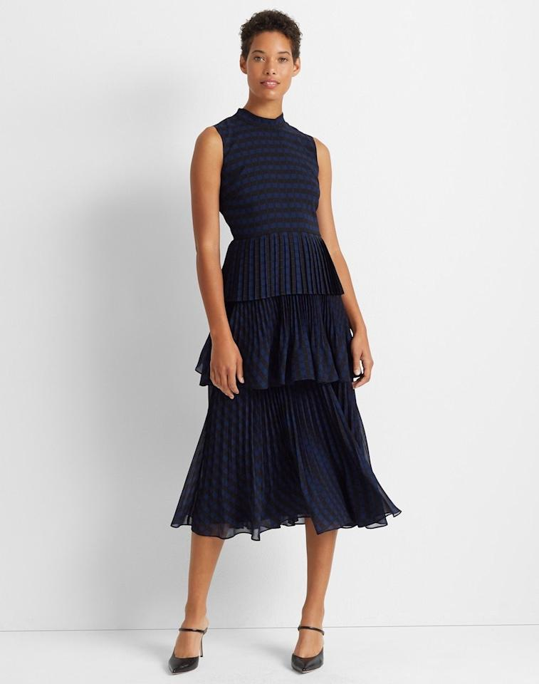 "<p>Playful tiered layers and a neutral navy hue make this midi dress a no-brainer for fall weddings. Pair it with a blazer or leather jacket, and you've got a wedding-ready look that's office appropriate too.</p> <p><strong>To buy: </strong>$298; <a href=""https://click.linksynergy.com/deeplink?id=93xLBvPhAeE&mid=37811&murl=https%3A%2F%2Fwww.clubmonaco.com%2Fen%2Fwomen-clothing-dresses%2Ftiered-pleated-dress%2F501877.html&u1=RS%2CFallWeddingGuestDressesThat%2527llWow%2Crsylvester805%2CWED%2CIMA%2C674327%2C201909%2CI"" target=""_blank"">clubmonaco.com</a>.</p>"