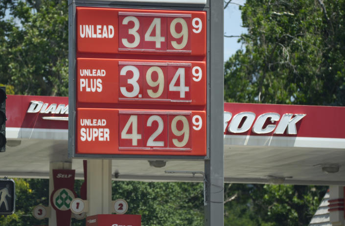 Prices for the three grades of gasoline available are posted outside a Diamond Shamrock station Thursday, July 22, 2021, in Denver. Colorado motorists are dealing with some of the highest prices at the pump in more than decade. (AP Photo/David Zalubowski)