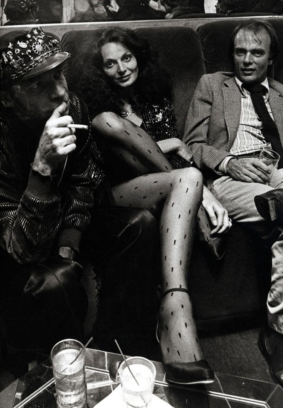 "<p>Diane Von Furstenberg lounges on the couches at Studio 54 in 1978, alongside her friend, Ara Gallant. She was at the nightclub for the launch of her husband Egor Von Furstenberg's book, <em><a href=""https://www.amazon.com/Power-Look-Egon-von-Furstenberg/dp/0030204569"" rel=""nofollow noopener"" target=""_blank"" data-ylk=""slk:The Power Look"" class=""link rapid-noclick-resp"">The Power Look</a></em>. </p>"