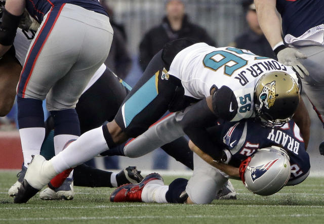 New England Patriots quarterback Tom Brady (12) is sacked by Jacksonville Jaguars defensive end Dante Fowler (56) during the first half of the AFC championship NFL football game, Sunday, Jan. 21, 2018, in Foxborough, Mass. (AP Photo/Steven Senne)