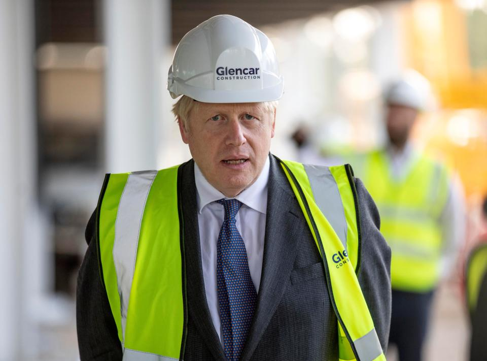 Britain's Prime Minister Boris Johnson visits the construction site of the new dedicated Vaccines Manufacturing Innovation Centre (VMIC) currently under construction on the Harwell science and innovations campus near Didcot in central England on September 18, 2020. - The building is being constructed to manufacture vaccines for Covid-19 and is set to open next summer. (Photo by RICHARD POHLE / POOL / AFP) (Photo by RICHARD POHLE/POOL/AFP via Getty Images)