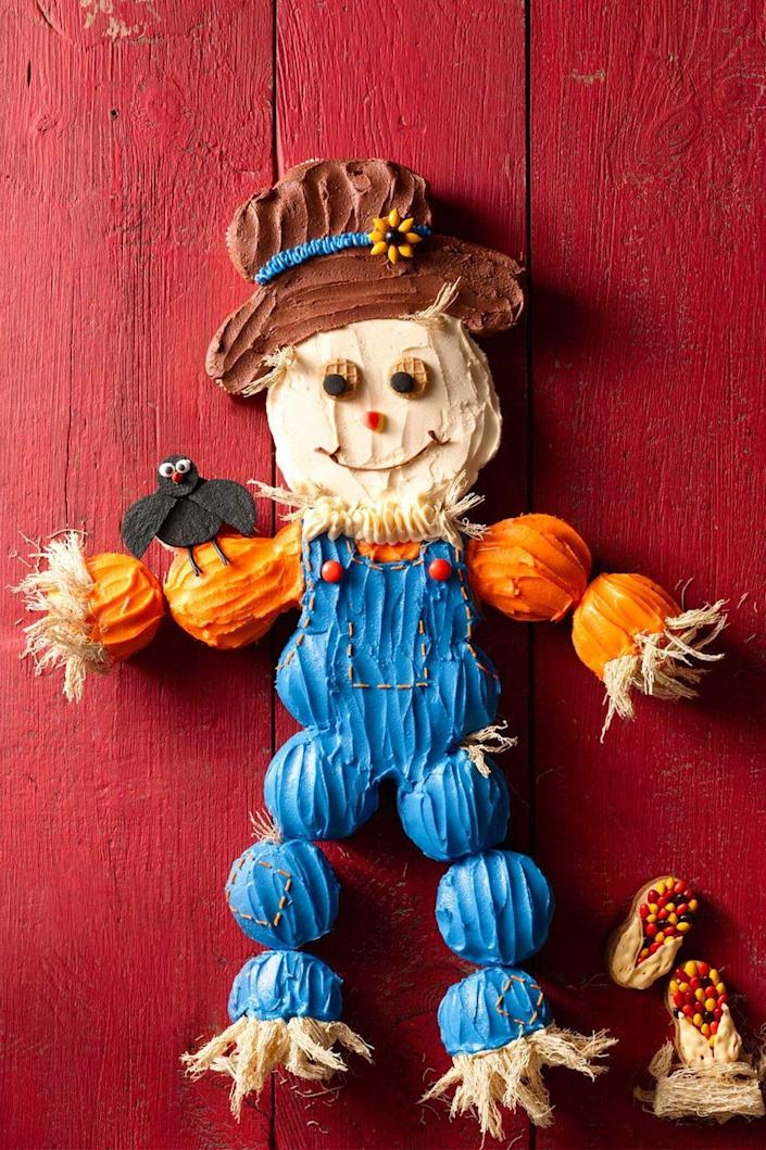 """<p>Have fun crafting this playful scarecrow that doubles as both decoration and dessert.</p><p><strong><em><a href=""""https://www.womansday.com/food-recipes/food-drinks/recipes/a56159/cupcake-scarecrow-recipe/"""" rel=""""nofollow noopener"""" target=""""_blank"""" data-ylk=""""slk:Get the Cupcake Scarecrow recipe."""" class=""""link rapid-noclick-resp"""">Get the Cupcake Scarecrow recipe. </a></em></strong> </p>"""