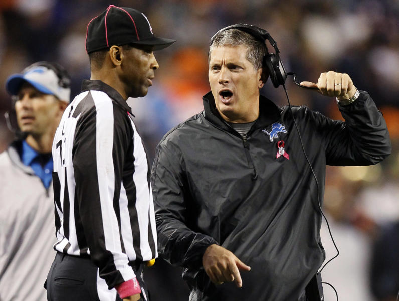 Detroit Lions head coach Jim Schwartz talks with line judge Ron Phares in the second half of an NFL football game against the Chicago Bears in Chicago, Monday, Oct. 22, 2012. (AP Photo/Charles Rex Arbogast)