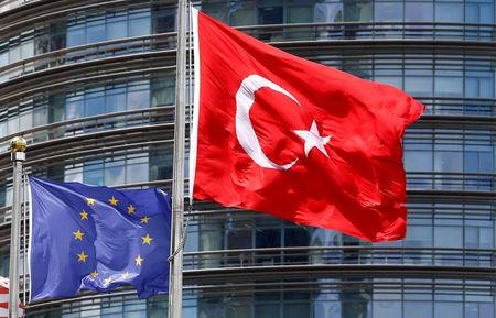 FILE PHOTO: A European Union (L) and Turkish flag fly outside a hotel in Istanbul, Turkey, May 4, 2016.  REUTERS/Murad Sezer/File Photo