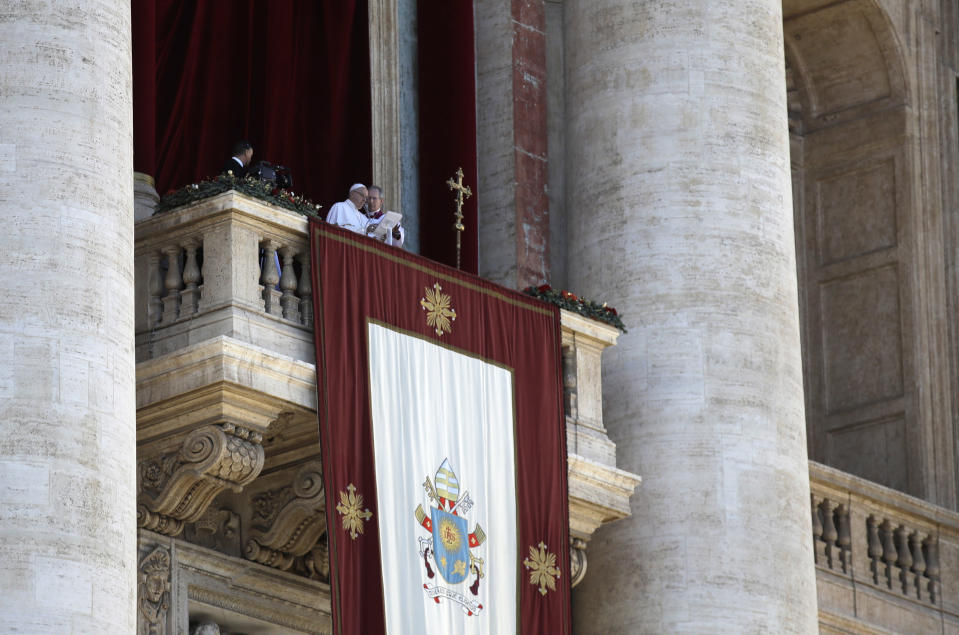 Pope Francis delivers his message during the Urbi et Orbi (Latin for 'to the city and to the world' ) Christmas' day blessing from the main balcony of St. Peter's Basilica at the Vatican, Tuesday, Dec. 25, 2018. (AP Photo/Alessandra Tarantino)