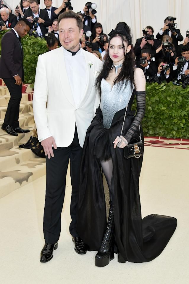 Elon Musk with new girlfriend Grimes. (Photo: Getty Images)