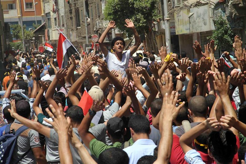 Egyptian supporters of the Muslim Brotherhood movement shout slogans during a rally to mark the first anniversary of the military ouster of president Mohamed Morsi, on July 3, 2014 in Cairo (AFP Photo/Khaled Kamel)