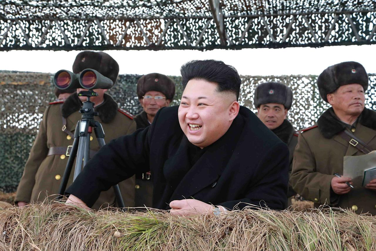 North Korean leader Kim Jong Un laughs as he watch a winter river-crossing attack drill of the armored infantry sub-units of the motorized strike group in the western sector of the front of the Korean People's Army (KPA) in this undated photo released by North Korea's Korean Central News Agency (KCNA) in Pyongyang January 27, 2015. REUTERS/KCNA (NORTH KOREA - Tags: POLITICS MILITARY) ATTENTION EDITORS - THIS PICTURE WAS PROVIDED BY A THIRD PARTY. REUTERS IS UNABLE TO INDEPENDENTLY VERIFY THE AUTHENTICITY, CONTENT, LOCATION OR DATE OF THIS IMAGE. FOR EDITORIAL USE ONLY. NOT FOR SALE FOR MARKETING OR ADVERTISING CAMPAIGNS. THIS PICTURE IS DISTRIBUTED EXACTLY AS RECEIVED BY REUTERS, AS A SERVICE TO CLIENTS. NO THIRD PARTY SALES. NOT FOR USE BY REUTERS THIRD PARTY DISTRIBUTORS. SOUTH KOREA OUT. NO COMMERCIAL OR EDITORIAL SALES IN SOUTH KOREA